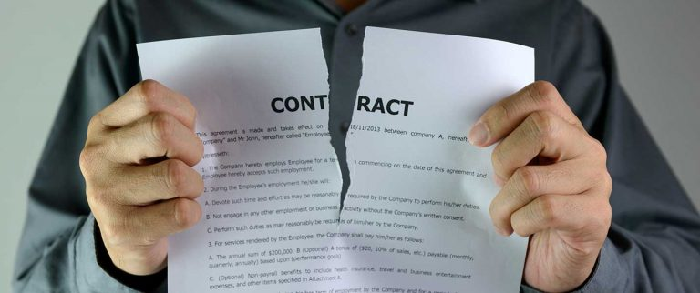 Man tearing up a contract